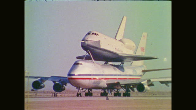 the space shuttle floats above the earth taxis runway for unveiling and sits atop a jetliner - water sports equipment stock videos and b-roll footage
