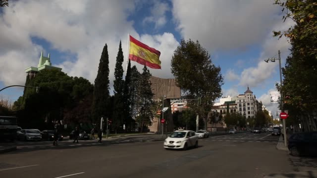 the spanish national flag flies in colon square in madrid spain on wednesday november 12 gvs of the flag - invertebrate stock videos & royalty-free footage