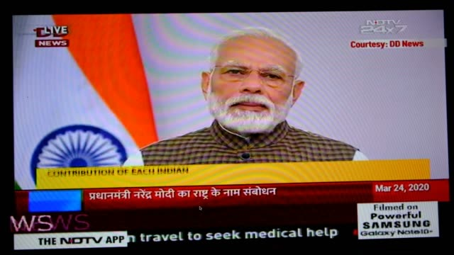 the speech being broadcasted live on ndtv news channel. the announcement affects the entire 1.3 billion population of india, the largest lockdown... - lockdown stock videos & royalty-free footage