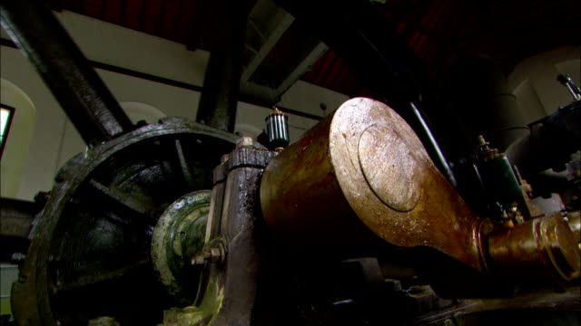 the spindle of a water wheel turns a mechanical arm. - wheel stock videos & royalty-free footage