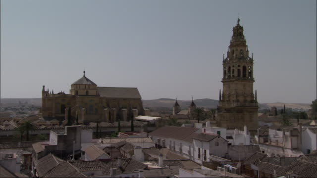 the spire of a church in cordoba towers over the city. - spire stock videos & royalty-free footage