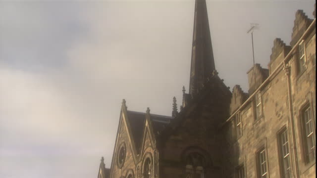 the spire of tolbooth church rises above edinburgh, scotland. - pinnacle stock videos & royalty-free footage