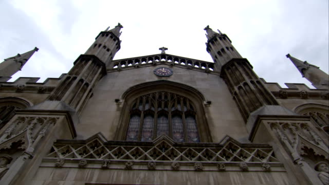 the spires of st. mary the great church against a cloudy sky at gonville and caius college, university of cambridge. available in hd. - cambridge university stock videos and b-roll footage