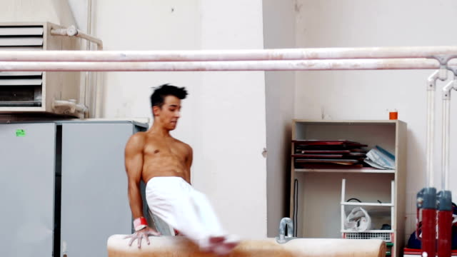 the sportsman during difficult exercise on pommel horse - washboard stock videos and b-roll footage