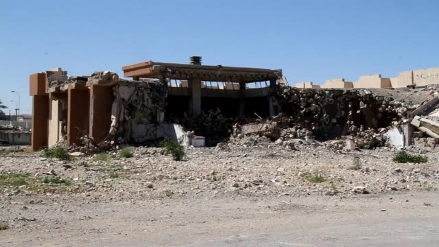 the sprawling palace compounds from which libyan leader moamer kadhafi ruled for four decades have been reduced to garbage dumps and pet markets by... - compounding stock videos and b-roll footage