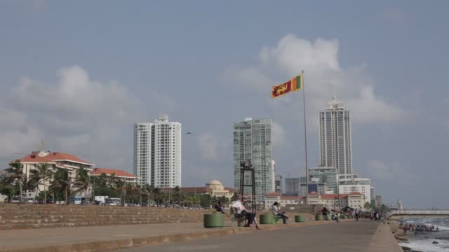 the sri lankan national flag flies at galle face green in colombo sri lanka on friday april 21 2017 - sri lankan flag stock videos & royalty-free footage
