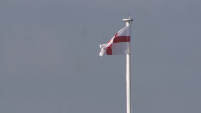 The St George's Cross of England flies from a flagpole in Windsor UK FKAU104L Clip taken from programme rushes AEZQ152Y