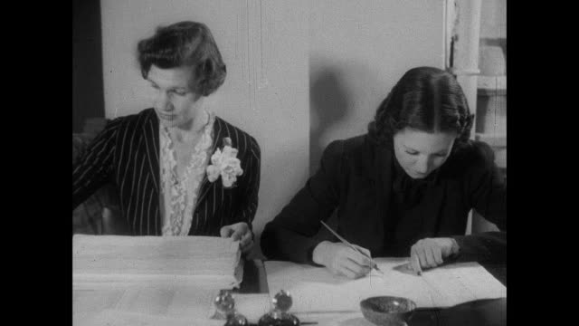 montage the staff at the national registration office work on updating information such as name, address, age, sex and job in the national register / united kingdom - census stock videos & royalty-free footage