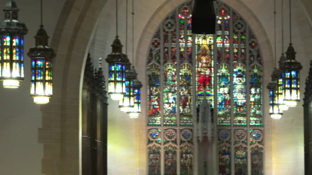 the stained glass inside of the toronto metropolitan united church which is located in the downtown district, ontario, canada. - electric lamp stock videos & royalty-free footage