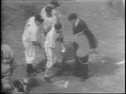 The stands are filled in Pittsburgh for the twelfth annual AllStar Classic baseball game / night game is played at Forbes Field / coaches shake hands...