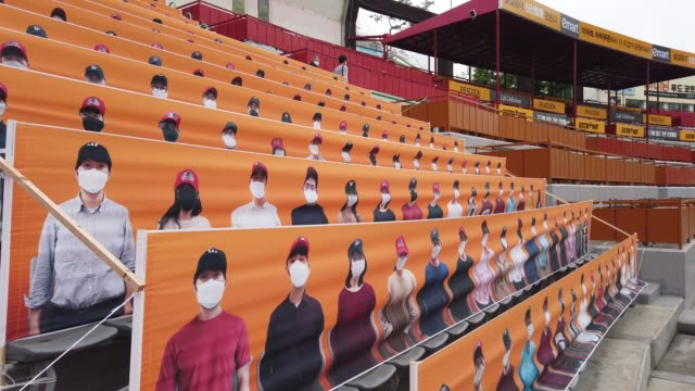 the stands at sk wyverns club's happy dream ballpark are filled with placards featuring their fans during the korean baseball organization league... - coreano video stock e b–roll
