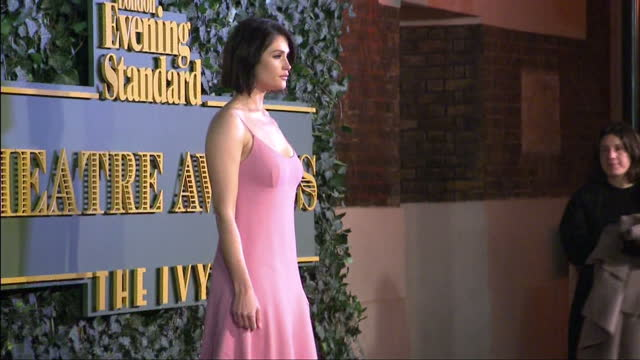 The stars of London's West End attend the Evening Standard Theatre Awards at the Old Vic Shows exterior shots Gemma Arterton on the red carpet posing...