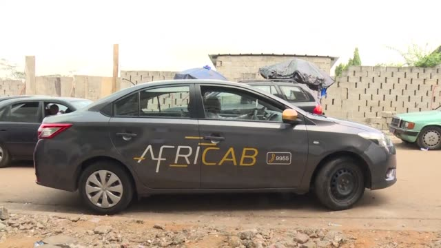 the start up company africab is revolutionising public transport in abidjan with a new fleet of taxis offering customers fixed fares an online... - fleet of vehicles stock videos and b-roll footage