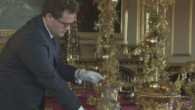 the state dining room set with silver-gilt pieces from the grand service, commissioned by george iv and still used today by the queen and her guests... - king royal person stock videos & royalty-free footage