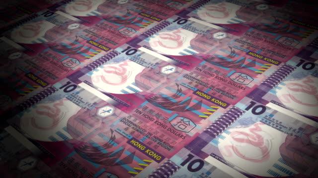 die staatliche münze druckt 10 hongkong-dollar-banknoten - geldpresse stock-videos und b-roll-filmmaterial