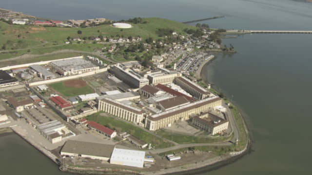 aerial the state prison and the still waters of the bay / san quentin, california, united states - federal prison building stock videos & royalty-free footage