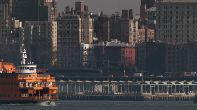 the staten island ferry crosses new york harbor. - staten island stock videos and b-roll footage