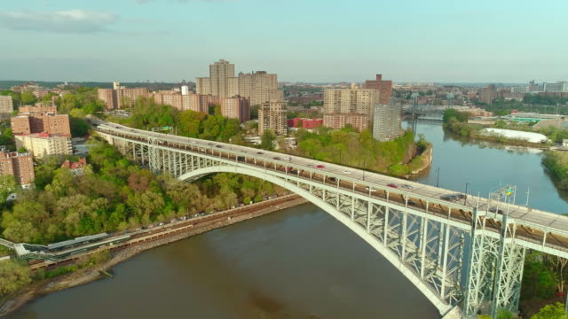 the static scenic panoramic aerial view to bronx over the henry hudson bridge, along the hudson river. - bronx stock videos and b-roll footage