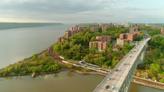 the static scenic panoramic aerial view to bronx over the henry hudson bridge, along the hudson river. - bronx new york stock videos and b-roll footage