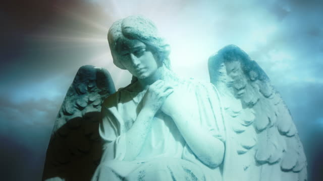 the statue of an angel on time lapse blue clouds. - statue stock videos & royalty-free footage