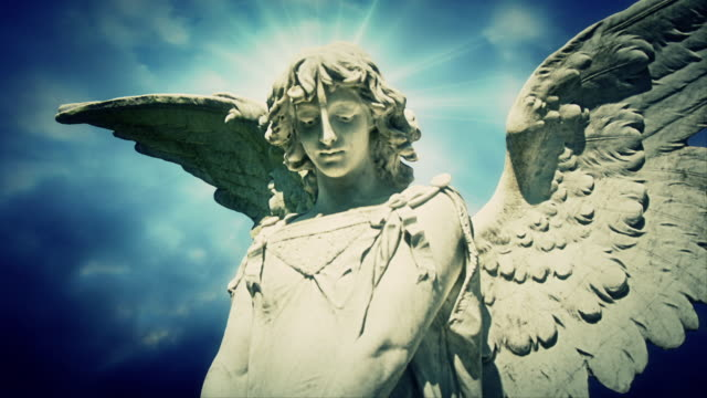 the statue of an angel on time lapse clouds - innocence stock videos & royalty-free footage