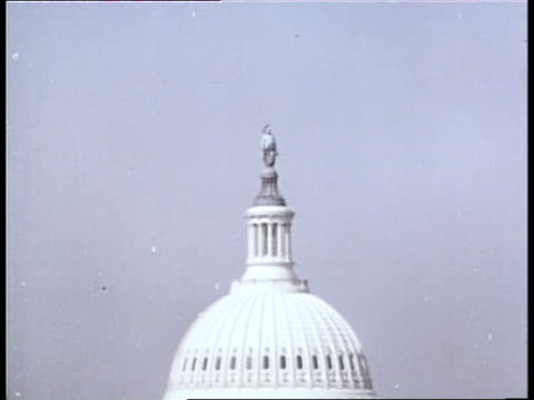 the statue of freedom tops the dome of the us capitol in washington dc - united states congress stock videos & royalty-free footage