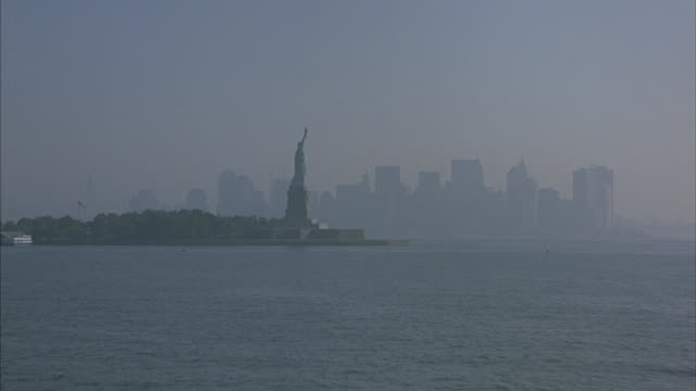the statue of liberty and the new york city skyline. - female likeness stock videos & royalty-free footage
