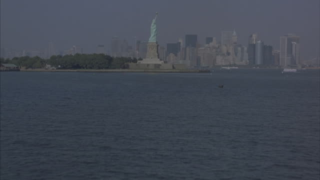 the statue of liberty and the new york city skyline. - 50 seconds or greater stock videos & royalty-free footage
