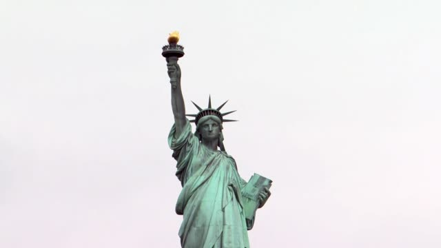 the statue of liberty exteriors from the water shot from ferry boat - statue of liberty new york city stock videos & royalty-free footage