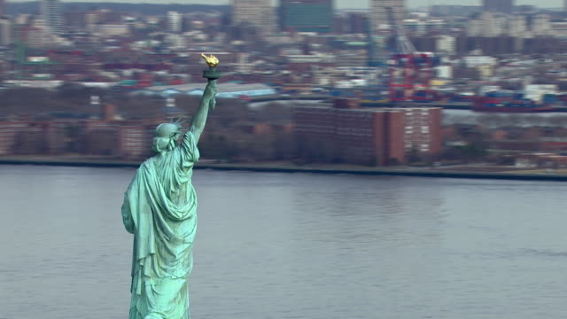 The Statue of Liberty looks out over New York City and the New York Harbor.