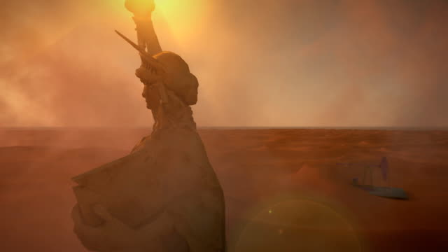 The Statue of Liberty raises her torch amid smoke and dust in a middle eastern oilfield.