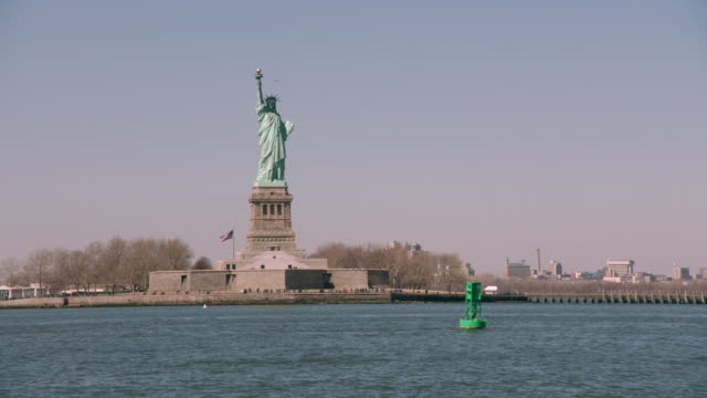 ws the statue of liberty standing above new york harbor / new york, united states - sculpture stock videos and b-roll footage