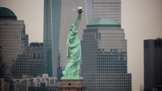 the statue of liberty with the downtown manhattan featured behind - statue of liberty stock videos and b-roll footage
