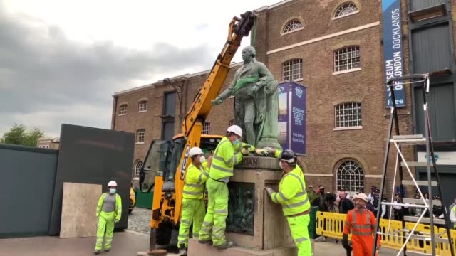 the statue of slave owner robert milligan at west india quay, east london, has been taken down after its owner agreed to demands on june 09, 2020.... - slavery stock videos & royalty-free footage