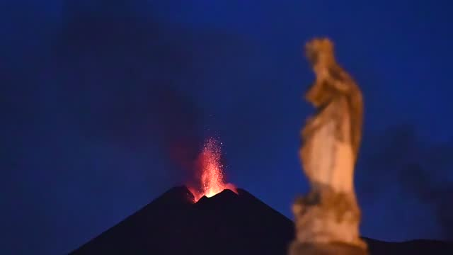the statue of the immaculate madonna in milo is shown lit in the shadow of mount etna, which has been spewing lava, ash and volcanic rock on a... - sorghum stock videos & royalty-free footage