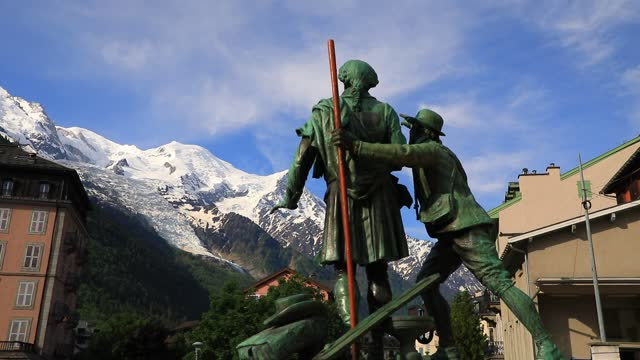 the statue of the mountaineers horace bénédict de saussure and jacques balmat looking towards the mont blanc on june 12, 2021 in chamonix, france.... - ski resort stock videos & royalty-free footage