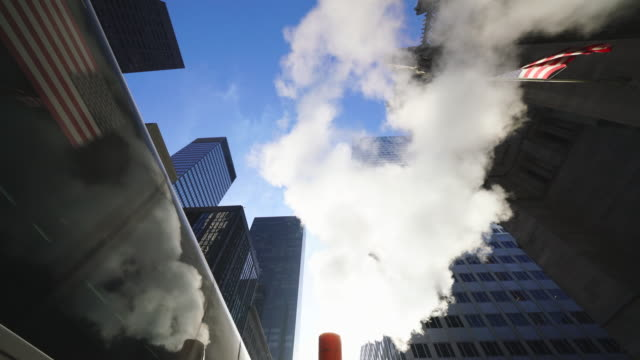 the steam rises and drifts among the rows of midtown manhattan buildings during the christmas holiday seasons in new york city ny usa on dec. 23 2019. - vapour trail stock videos & royalty-free footage