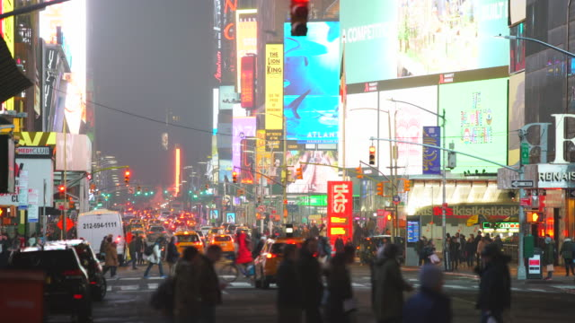 the steam rises and drifts over the avenue among the midtown manhattan buildings in the night, which glow and illuminated from digital billboard around the times square in midtown manhattan new york city ny usa on jan. 14 2020. - avenue stock videos & royalty-free footage