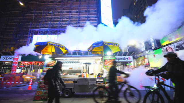 the steam rises and drifts over the hotdog stand among the midtown manhattan buildings in the night around the times square in midtown manhattan new york city ny usa on jan. 14 2020. - travel destinations stock videos & royalty-free footage