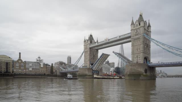 the steam ship waverly passing through tower bridge london - tower bridge stock videos & royalty-free footage