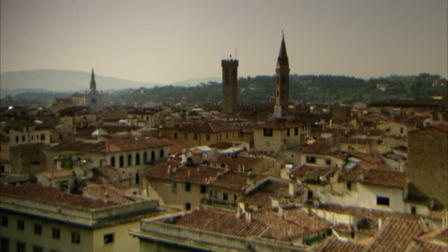 the steeple and bell tower of the basilica di santa maria del fiore tower above the city of florence. available in hd. - steeple stock videos & royalty-free footage