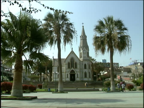 the steeple of the church rises amidst palm trees. - steeple stock videos & royalty-free footage