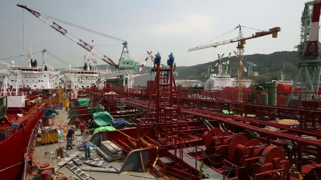 the sti fulham chemical and oil tanker owned by scorpio commercial management sits at dock under construction at the hyundai mipo dockyard co... - 造船所の労働者点の映像素材/bロール