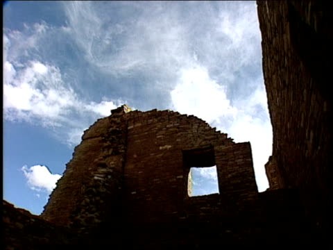 the stone walls of the pueblo bonito ruins rise into the sky. - ultra high definition television stock videos & royalty-free footage