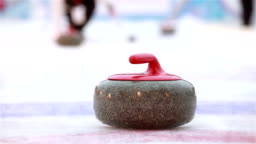 The stones for Curling on the ice.