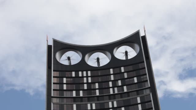 the strata building at the elephant and castle in london, is the first building in the world where wind turbines have been integrated into the fabric... - energy efficient stock videos & royalty-free footage
