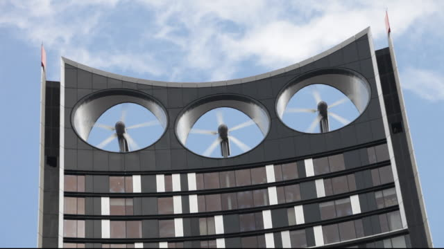 vídeos de stock, filmes e b-roll de the strata building at the elephant and castle in london, is the first building in the world where wind turbines have been integrated into the fabric of the building. - energy efficient