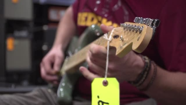 the stratocaster an instrument emblematic of modern us music has been to a large extent manufactured in mexico - modern rock stock videos & royalty-free footage