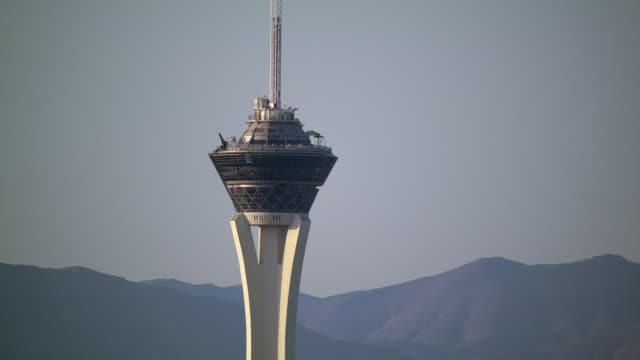 the stratosphere towers over las vegas, nevada. - clark county nevada stock videos and b-roll footage