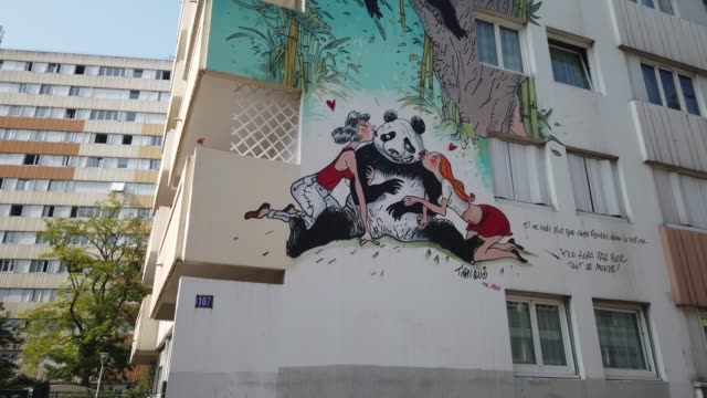 the street artist nilko drawns a mural in tribute to cartoonist tignous, killed in the attack on charlie hebdo in january 2015, on september 14, 2020... - cartoonist stock videos & royalty-free footage